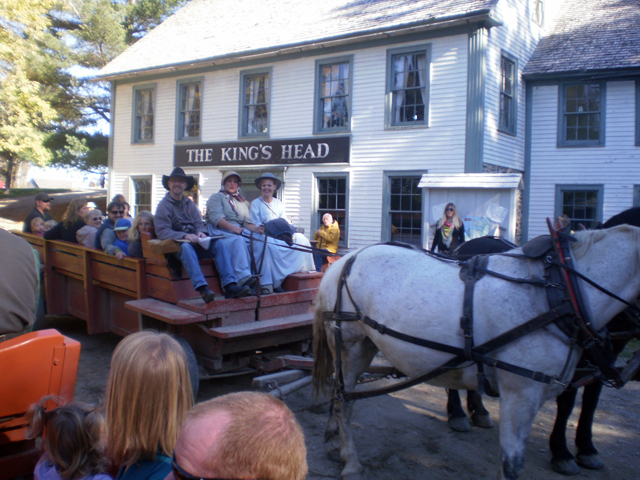 Horse Drawn Wagon with passengers.